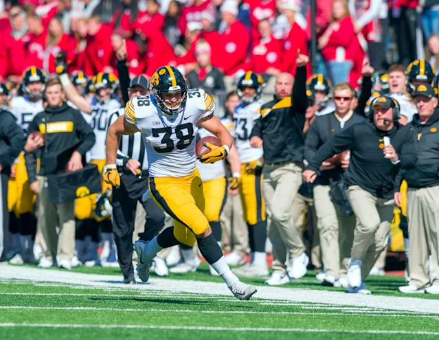 Iowa tight end T.J. Hockenson runs the ball up the sideline against Indiana. (AP Photo)