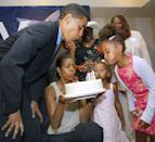 <p>Barack blows out candles on his 43rd birthday cake [Photo: Tim Boyle/Getty] </p>