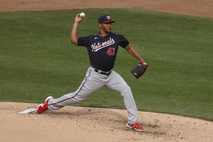 Washington Nationals' Joe Ross delivers a pitch during the third inning of a baseball game against the New York Mets, Saturday, April 24, 2021, in New York. (AP Photo/Jason DeCrow)