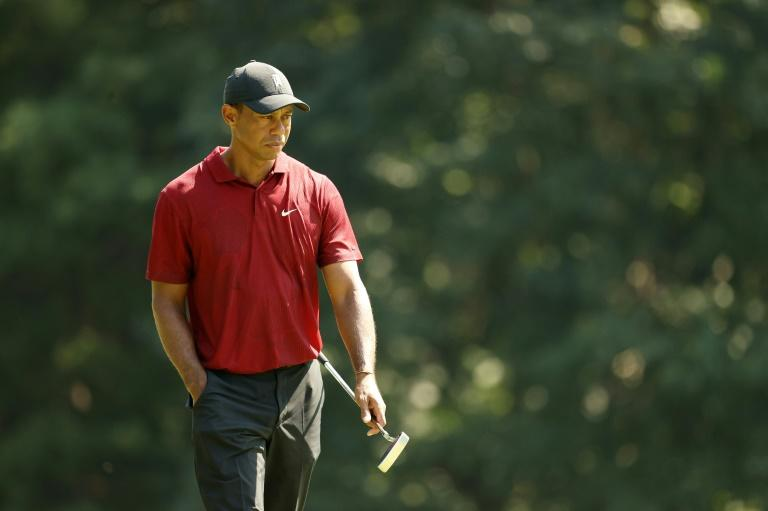 Tiger closes with 66 but faces work in US PGA playoffs