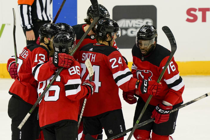 New Jersey Devils defenseman P.K. Subban (76) celebrates with his teammates after scoring during the third period of an NHL hockey game against the Buffalo Sabres, Saturday, Feb. 20, 2021, in Newark, N.J. (AP Photo/John Minchillo)