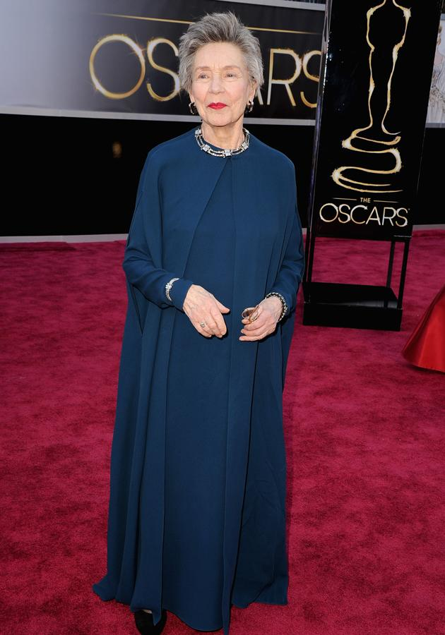 Emanuelle Riva looked demure in a midnight-blue gown and matching flowing jacket ©Getty
