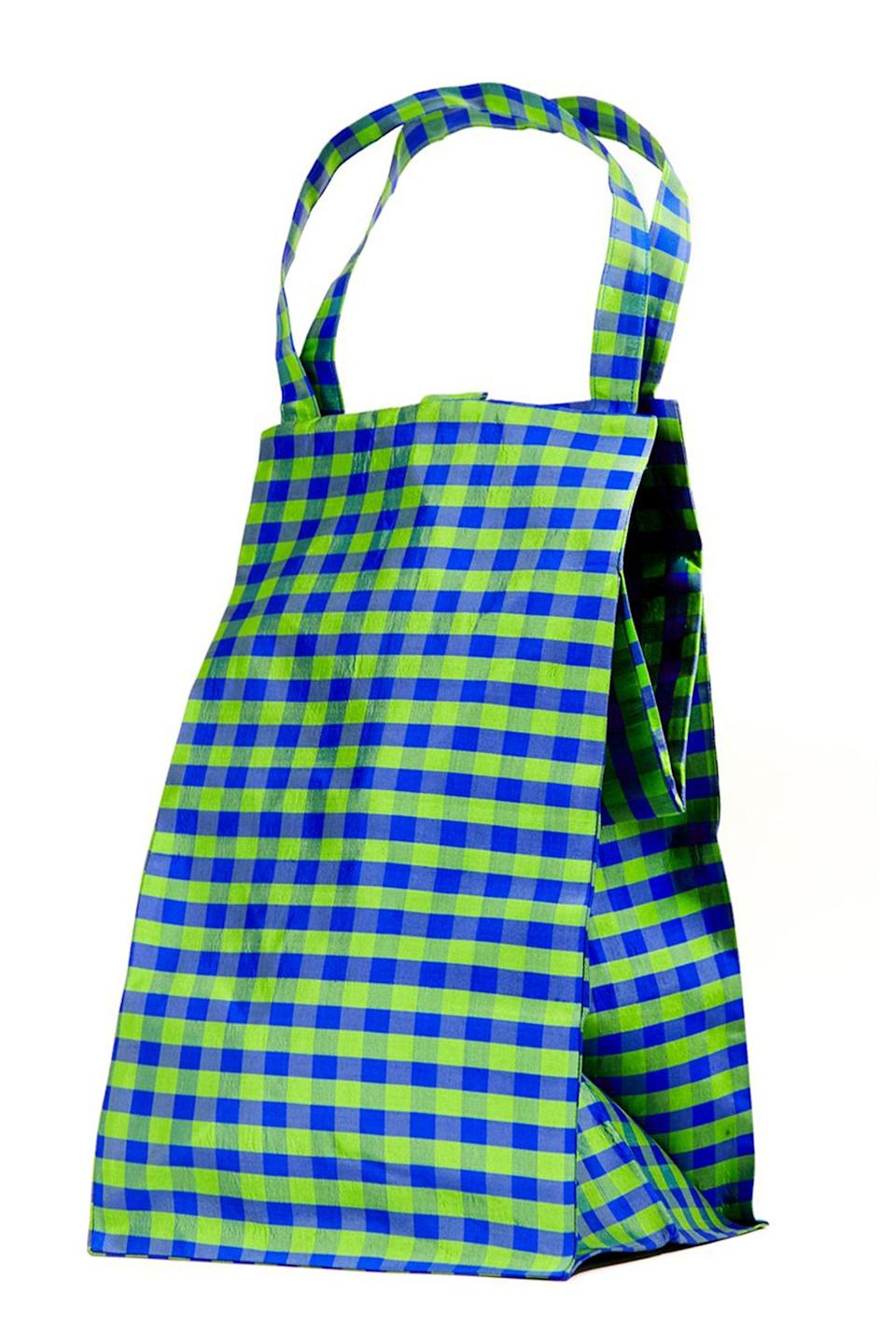 """<p><strong>COA-NYC</strong></p><p>coa-nyc.com</p><p><strong>$235.00</strong></p><p><a href=""""https://coa-nyc.com/collections/all/products/gingham-lime-blue-everyday-bag"""" rel=""""nofollow noopener"""" target=""""_blank"""" data-ylk=""""slk:Shop Now"""" class=""""link rapid-noclick-resp"""">Shop Now</a></p><p>COA-NYC, short for Coming of Age, stays true to its name as the brand incorporates playful colors and practical designs that were inspired by the designer Luri's childhood in Miami. This cute Everyday Bag reminds us of school lunch bags, upgraded in silk gingham sourced from the garment district in NYC.</p>"""