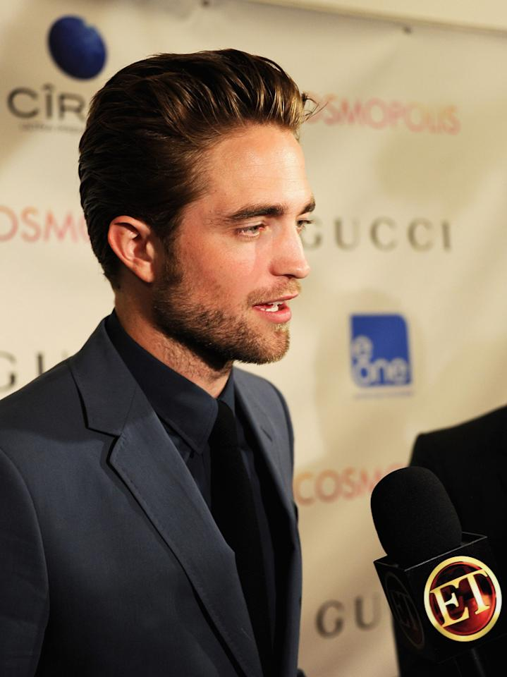 "Robert Pattinson chats with reporters at the New York premiere of ""Cosmopolis"" on August 13, 2012."