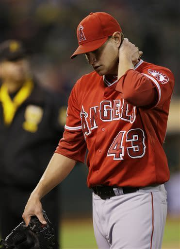 Los Angeles Angels starting pitcher Garrett Richards walks back to the dugout after a three-run inning from the Oakland Athletics during the fifth inning of a baseball game on Tuesday, April 30, 2013 in Oakland. Calif. (AP Photo/Marcio Jose Sanchez)