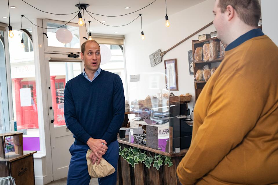 KING'S LYNN, ENGLAND - JUNE 19: Prince William, Duke of Cambridge speaks to member of staff Ted Bartram during a visit to Smiths the Bakers, in the High Street on June 19, 2020 in King's Lynn, Norfolk. (Photo by Aaron Chown/WPA Pool/Getty Images)