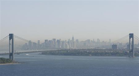 A layer of smog can be seen above Manhattan through the Verrazano-Narrows Bridge in New York