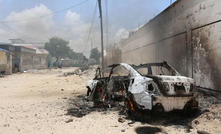 A burning car is seen after a clash among gunmen and security members, in Madina district of Somalia's capital Mogadishu