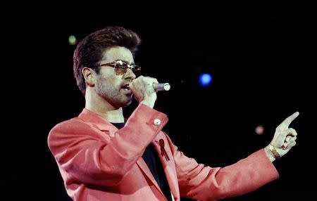 FILE PHOTO - Singer George Michael performs at the Freddie Mercury Tribute Concert for AIDS Awareness, at Wembley Stadium, in London Britain April 20, 1992.  REUTERS/Dylan Martinez/File Photo