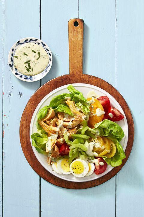 """<p>The classic wing flavors pair up with lettuce, tomatoes, and eggs, all dressed up in <a href=""""https://www.goodhousekeeping.com/food-recipes/a39937/avocado-buttermilk-ranch-dressing-recipe/"""" rel=""""nofollow noopener"""" target=""""_blank"""" data-ylk=""""slk:a classic spin of buttermilk ranch dressing"""" class=""""link rapid-noclick-resp"""">a classic spin of buttermilk ranch dressing</a>. Looking to up your ratios? Add 1 ounce of crumbled blue cheese to each serving.</p><p><em><a href=""""https://www.goodhousekeeping.com/food-recipes/a39936/buffalo-chicken-cobb-salad-recipe/"""" rel=""""nofollow noopener"""" target=""""_blank"""" data-ylk=""""slk:Get the recipe for Buffalo Chicken Cobb Salad »"""" class=""""link rapid-noclick-resp"""">Get the recipe for Buffalo Chicken Cobb Salad »</a></em></p>"""