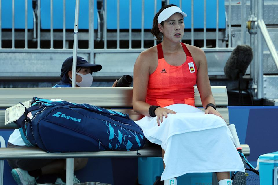 Spain's Garbine Muguruza sits on the bench during her Tokyo 2020 Olympic Games women's doubles third round tennis match against Belgium's Alison van Uytvanck at the Ariake Tennis Park in Tokyo on July 27, 2021. (Photo by Giuseppe CACACE / AFP) (Photo by GIUSEPPE CACACE/AFP via Getty Images)
