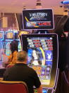 A man plays a slot machine at the Hard Rock casino in Atlantic City N.J., on Monday, June 28, 2021. Hard Rock last year finished second only to the Borgata in terms of money won from in-person gamblers. (AP Photo/Wayne Parry)