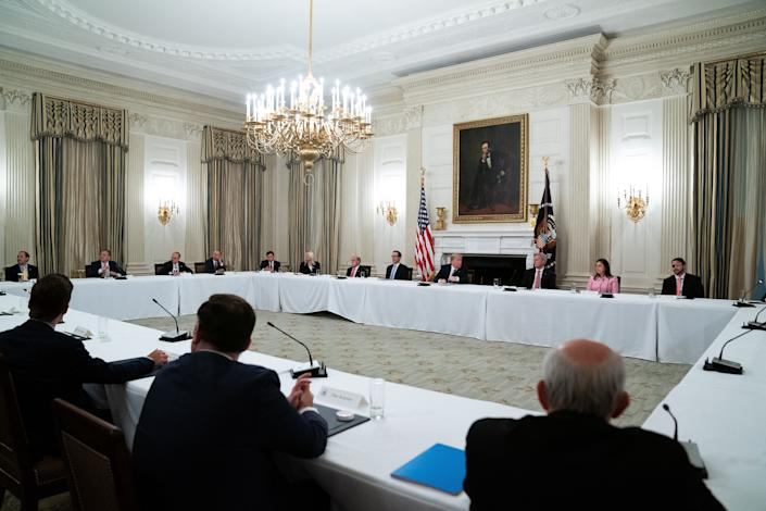 Here's a view of Trump's meeting with House Republicans. That is not 6 feet of space between each person. (Photo: Pool via Getty Images)