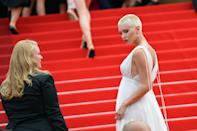 """<p>Much has been made of the ties between major life changes and dramatic beauty moves. The <a href=""""https://www.harpersbazaar.com/uk/beauty/hair/news/a40296/this-is-why-women-really-cut-off-their-hair-post-break-up/"""" rel=""""nofollow noopener"""" target=""""_blank"""" data-ylk=""""slk:break-up haircut"""" class=""""link rapid-noclick-resp"""">break-up haircut</a> has been immortalised on television (perhaps none more memorable than Keri Russell in Felicity) while countless A-listers have emerged with a dramatic new look following a publicised split. </p><p>Synonymous with new beginnings, a major style overhaul can indeed refresh your outlook, helping draw that line under a challenging period of time. Now, the post-relationship haircut has become the post-pandemic haircut, and we're all ready to embrace the change.</p><p>Perhaps a <a href=""""https://www.harpersbazaar.com/uk/beauty/hair/g27626363/best-hair-colourists-london/"""" rel=""""nofollow noopener"""" target=""""_blank"""" data-ylk=""""slk:fresh head of highlights"""" class=""""link rapid-noclick-resp"""">fresh head of highlights</a> will do it for you, or a new <a href=""""https://www.harpersbazaar.com/uk/beauty/hair/a21201349/going-blonde-professional-tips/"""" rel=""""nofollow noopener"""" target=""""_blank"""" data-ylk=""""slk:icy-blonde hue"""" class=""""link rapid-noclick-resp"""">icy-blonde hue</a>. Bolder? Maybe <a href=""""https://www.harpersbazaar.com/uk/beauty/hair/g33790910/pink-hair-trend/"""" rel=""""nofollow noopener"""" target=""""_blank"""" data-ylk=""""slk:pink"""" class=""""link rapid-noclick-resp"""">pink</a> is your 2021 mood. But if you're seeking maximum catharsis, the summer's boldest beauty move is for you: the buzzcut is back.</p><p>This week, Iris Law walked the Cannes red carpet with a bleached-blonde buzzcut, while <a href=""""https://www.instagram.com/p/CRPHlKsoH1G/"""" rel=""""nofollow noopener"""" target=""""_blank"""" data-ylk=""""slk:Jada Pinkett Smith"""" class=""""link rapid-noclick-resp"""">Jada Pinkett Smith</a> marked the arrival of her 50th decade by shaving off her blonde hair: a move that was initiated by dau"""