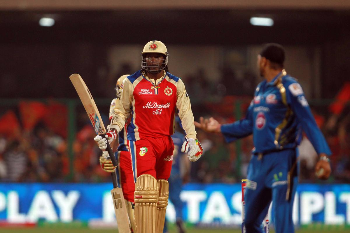 Chris Gayle celebrates his half century during match 2 of of the Pepsi Indian Premier League between The Royal Challengers Bangalore and The Mumbai Indians held at the M. Chinnaswamy Stadium, Bengaluru on the 4th April 2013. Photo by Jacques Rossouw/IPL/SPORTZPICS  ..Use of this image is subject to the terms and conditions as outlined by the BCCI. These terms can be found by following this link:..https://ec.yimg.com/ec?url=http%3a%2f%2fwww.sportzpics.co.za%2fimage%2fI0000SoRagM2cIEc&t=1490292399&sig=l8P65R5awwTf_ivFJ_6dTQ--~C