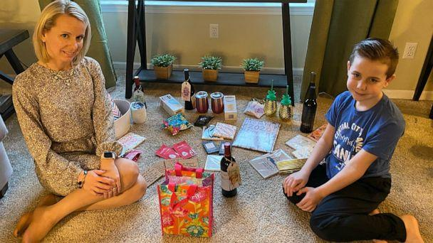 PHOTO: Tracy Murley and her son prepare a gift basket to deliver for the Sisterhood of the Traveling Wine. (Courtesy Tracy Murley)