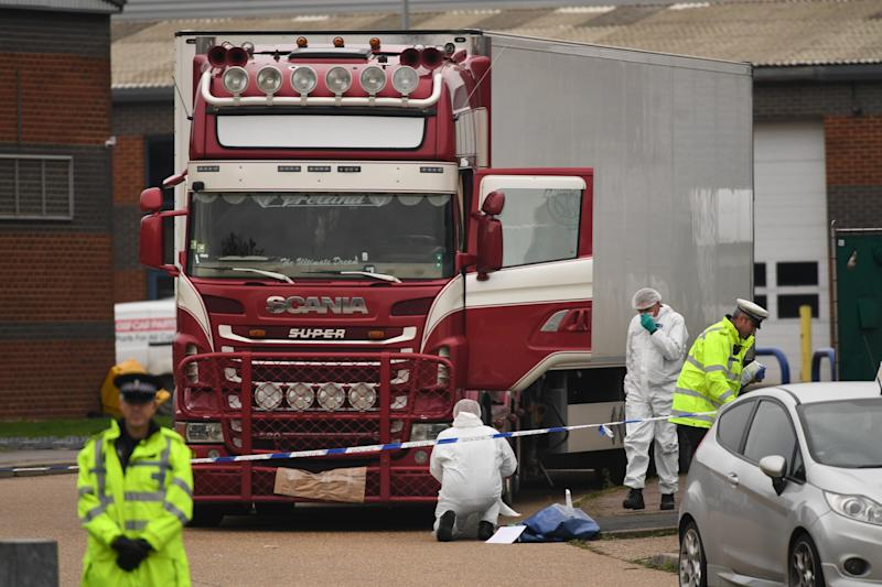 File photo dated 23/10/2019 of police and forensic officers at the Waterglade Industrial Park in Grays, Essex, after 39 bodies of Vietnamese migrants were found inside the lorry on the industrial estate. Irish haulier Ronan Hughes is due to appear in court over their deaths, after he was extradited to the UK.