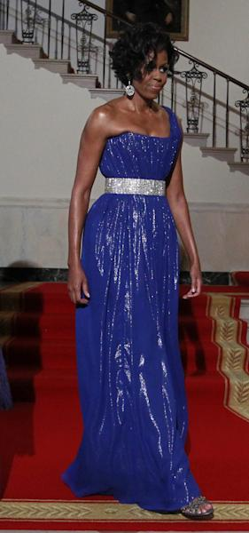 FILE - This May 19, 2010 file photo shows first lady Michelle Obama at a State Dinner at the White House in Washington. Obama wore a gown designed by Peter Soronen. Obama has proven her fashion savvy time and time again since she was introduced to the country as first lady on Inauguration Day 2009. In the past four years she has adeptly walked the line between directional fashionista and everywoman. (AP Photo/Charles Dharapak, file)
