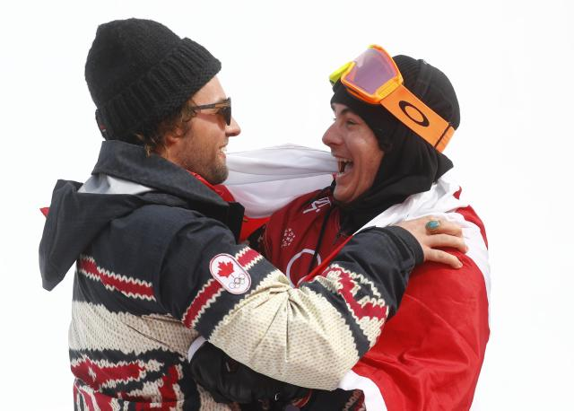 Snowboarding - Pyeongchang 2018 Winter Olympics - Men's Big Air Finals - Alpensia Ski Jumping Centre - Pyeongchang, South Korea - February 24, 2018 - Sebastien Toutant of Canada celebrates with a teammate. REUTERS/Kai Pfaffenbach