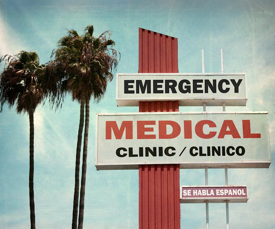 aged and worn medical clinic sign