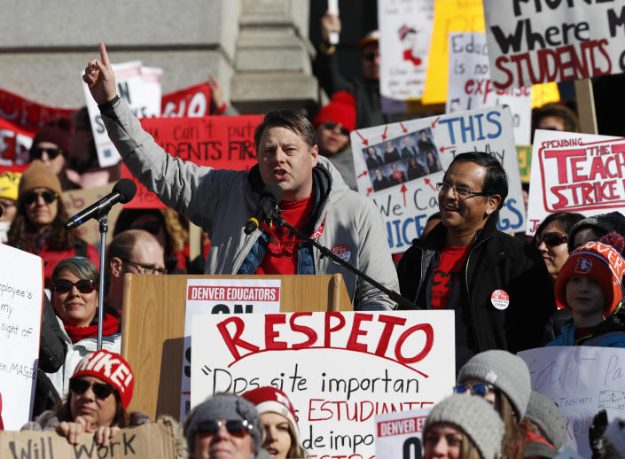 Rob Gould, center left, a special education teacher and lead Denver Classroom Teachers Association negotiator, and Henry Roman, center right, president of the teachers union, speak to teachers during a strike rally on the west steps of the State Capitol Monday, Feb. 11, 2019, in Denver. The strike is the first for teachers in Denver since 1994 and centers on base pay. (AP Photo/David Zalubowski)