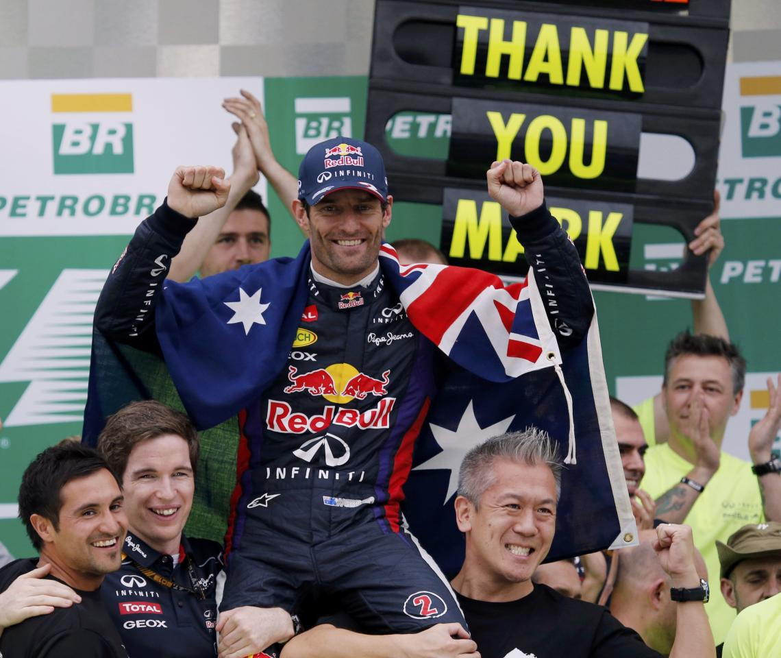 Red Bull Formula One driver Mark Webber of Australia is carried as the Red Bull team celebrates their win in the F1 Grand Prix, after the Brazilian F1 Grand Prix at the Interlagos circuit in Sao Paulo November 24, 2013. REUTERS/Nacho Doce (BRAZIL - Tags: SPORT MOTORSPORT F1)