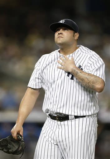 New York Yankees relief pitcher Joba Chamberlain (62) reacts returning to the dugout after allowing an eighth-inning infield single to New York Mets designated hitter John Buck in the an interleague baseball game at Yankee Stadium in New York, Thursday, May 30, 2013. The Mets won 3-1. (AP Photo/Kathy Willens)