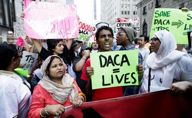 <p>People gather for a rally and protest to mark the fifth anniversary of the Deferred Action for Childhood Arrivals (DACA) program near Trump Tower in New York City, August 2017. (Photo: Justin Lane/EPA/REX/Shutterstock) </p>