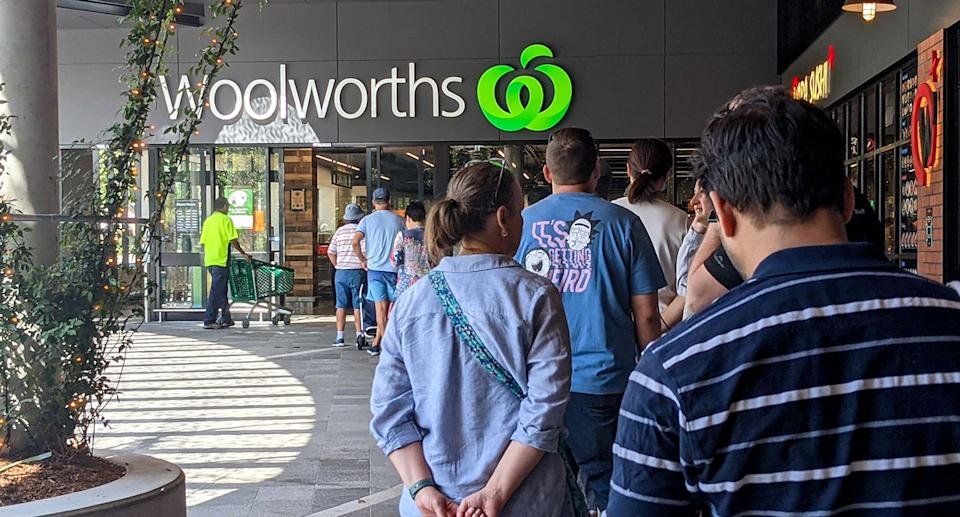 Woolworths shoppers line up outside store during pandemic. Source: AAP