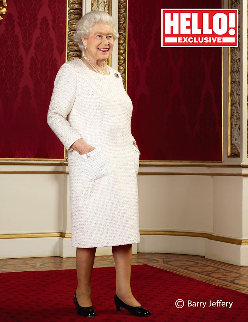 Queen Elizabeth smiling posing for Hello! magazine with her hands in her pockets