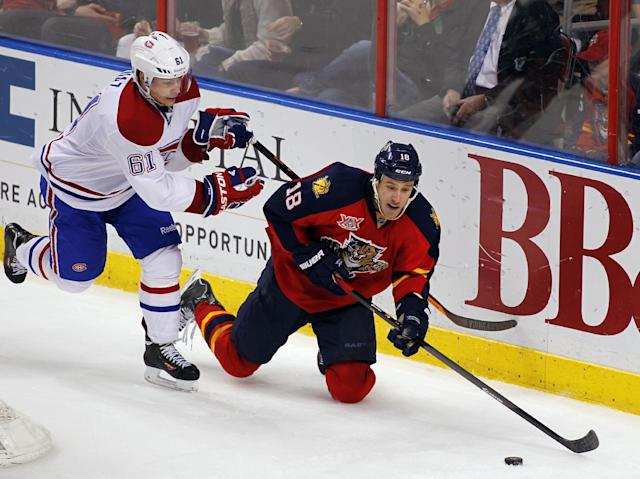 Florida Panthers center Aleksander Barkov (16) is checked by Montreal Canadiens defenseman Raphael Diaz (61) during the second period of an NHL hockey game in Sunrise, Fla., Sunday, Dec. 29, 2013. (AP Photo/Terry Renna)