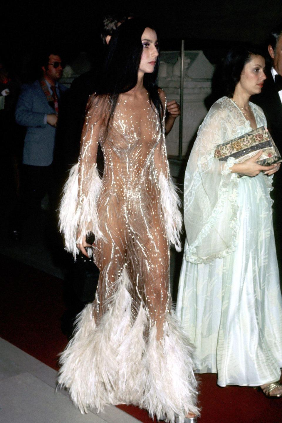 <p>Cher (with the help of designer Bob Mackie, naturally) practically invented the naked dress that we see so many celebs rock today. </p>