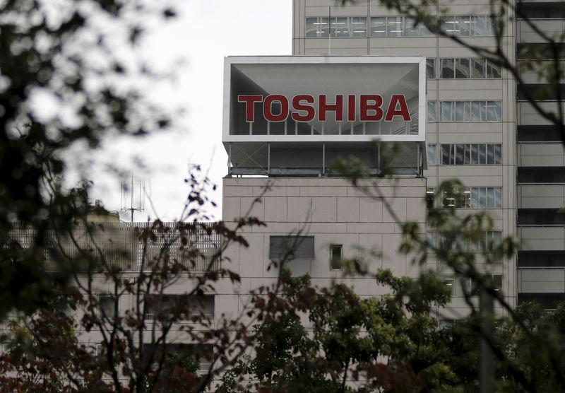 The logo of Toshiba Corp is seen behind trees at its headquarters in Tokyo