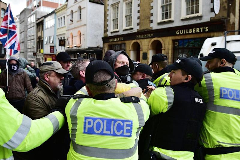 Violent clashes: Police contain demonstrators as far right and anti-fascist campaigners protest in Bristol city centre (PA)