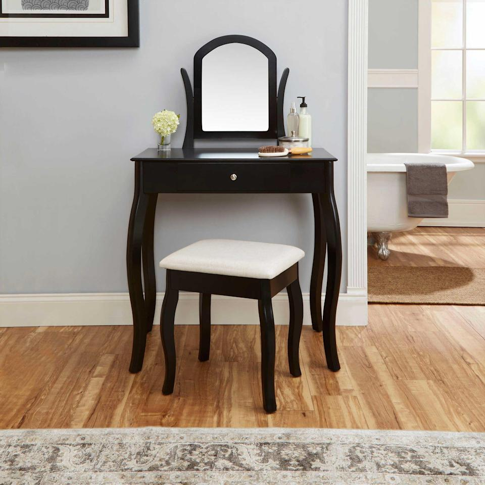 <p>If you like an all-black aesthetic, opt for this clean-lined <span>Bed Bath &amp; Beyond Traditional Vanity Set</span> ($150), which will add style and a practical surface area to your space.</p>