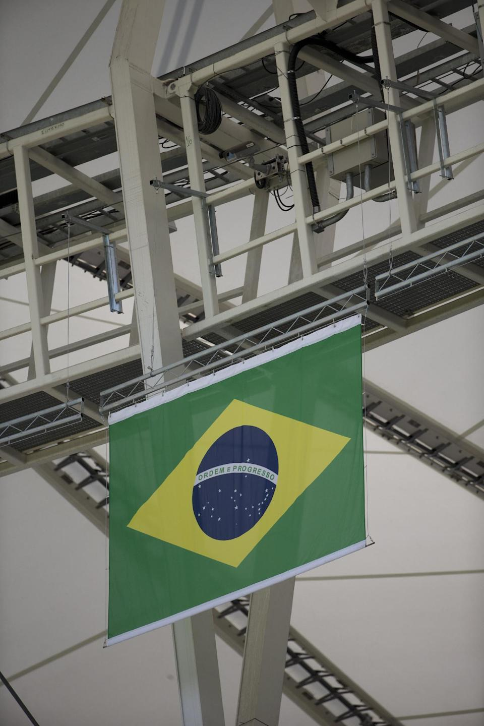 "A camera is set up in a catwalk at the Maracana stadium in Rio de Janeiro, Brazil, Monday, June 9, 2014. For the first time in a World Cup, goal-line technology will be used to determine whether a ball crosses the goal line. Fourteen cameras - seven trained on each goalmouth - have been hung from catwalks in all 12 World Cup stadiums. The cameras will record 500 images per seconds, and a computer will digest the frames. Within a second, the referee's special watch will vibrate and flash ""GOAL."" (AP Photo/Silvia Izquierdo)"