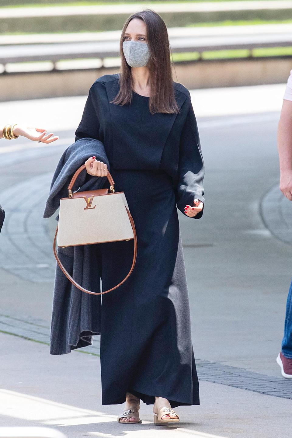 <p>A covered-up Angelina Jolie makes her way to The Brooklyn Museum in New York City on June 10.</p>