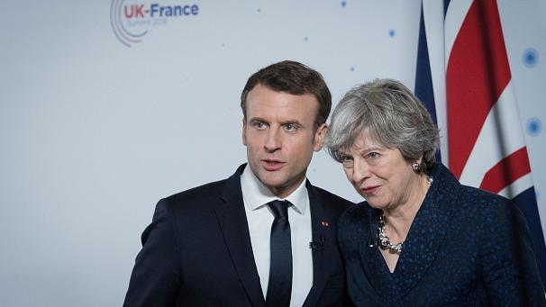 "The president of France, Emmanuel Macron, and the British Prime Minister Theresa May met for a bilateral Anglo-French summit on Thursday, the 35th between the pair. With Britain's turn to host the venue was especially significant; Sandhurst, where generations of army officers have been taught. The elite school provides NATO with key elements in its leadership, and Britain and France are by far the biggest military powers in the alliance after America, and UN Security Council members. For several years the British and French military establishments have been getting closer together with a view to forming a core group for a possible European defence force, and May announced the pair would soon be able to deploy a 10,000 man joint rapid reaction force to anywhere needed. Whatever the implications of Brexit Britain and France stand together on defence and security, it seems. Both leaders were keen to stress that leaving the EU for Britain did not mean leaving Europe, and that the bilateral ties with France would only strengthen in the future. However Macron again warned Britain that the single market was a red line no-one could cross, and that it was unrealistic to expect exactly the same single market conditions for a non-EU member. One issue has caused the pair serious problems for a decade; the arrival of hundreds of migrants in Calais trying to reach Britain. May said that was now being tackled. ""We will reinforce the security infraestructure with extra CCTV, fencing and infrared technology at Calais and other border points. The further investment we have agreed today will make the UK's borders even more secure,"" she said. Brexit was also never very far away, although Macron insisted it was not a core subject at the summit. However he did have this to say about single market membership. ""I am neither in favor of rewarding nor punishing states leaving the union, but I have a requirement. The single market has to be preserved because it is an asset of the European Union, and it is one of the bases of the EU. So now the choice is on the UK side, it's not on my side. But there can not be favouable access to the single market in which financial services are a part,"" he insisted. Both were keen to stress it would be business as usual come what may on a bilateral level; indeed it sounded as if, with a proliferation of exchanges and joint projects, the entente cordiale has rarely been as cordial."