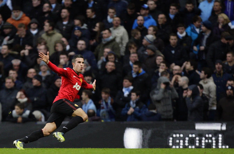Manchester United's Robin van Persie celebrates after scoring the winning goal against Manchester City during their English Premier League soccer match at The Etihad Stadium, Manchester, England, Sunday Dec. 9, 2012. United won the match 3-2.  (AP Photo/Jon Super)