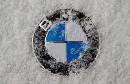 A frost covered logo of German luxury carmaker BMW is seen in Munich, Germany January 16, 2017. REUTERS/Michael Dalder