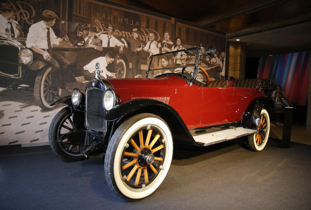 """FILE - In this March 25, 2019, file photo, The """"Hupmobile"""" is displayed at the annual NFL football owners meetings in Phoenix. Fifteen men were ready to launch the 10 charter teams of the National Football League in 1920. They gathered in Ralph Hay's car showroom in Canton, Ohio, and got down to business. Except for one problem: There weren't enough chairs for everyone. Instead, a few of the future owners of NFL franchises sat on the running boards of the Hupmobile in Hay's dealership. And when they were ready to sign the papers to establish the league, they leaned on the hood of the car to finish up. (AP Photo/Rick Scuteri, File)"""