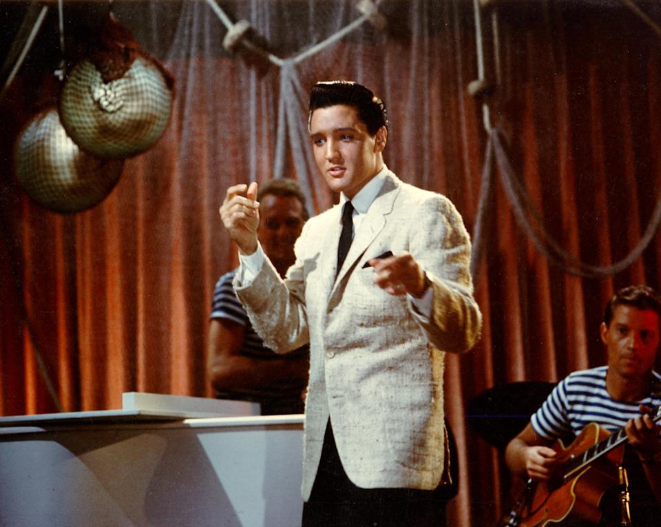 """LOS ANGELES - APRIL 1962: Rock and roll singer Elvis Presley performs in the film """"Girls Girls Girls"""" at Paramount Studios in April of 1962 in Los Angeles, California. (Photo by Michael Ochs Archives/Getty Images)"""