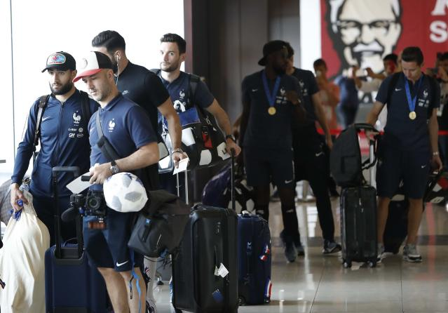 Soccer Football - World Cup - France Departure - Sheremetyevo International Airport, Moscow Region, Russia - July 16, 2018. Team members queue while passing through a security checkpoint before the departure. REUTERS/Sergei Karpukhin