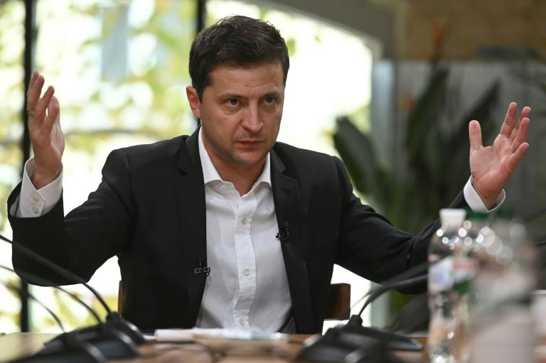"Ukrainian President Volodymyr Zelensky says ""if there is no pullback (of troops) there is no Normandy summit"" with Russian President Vladimir Putin (AFP Photo/GENYA SAVILOV)"
