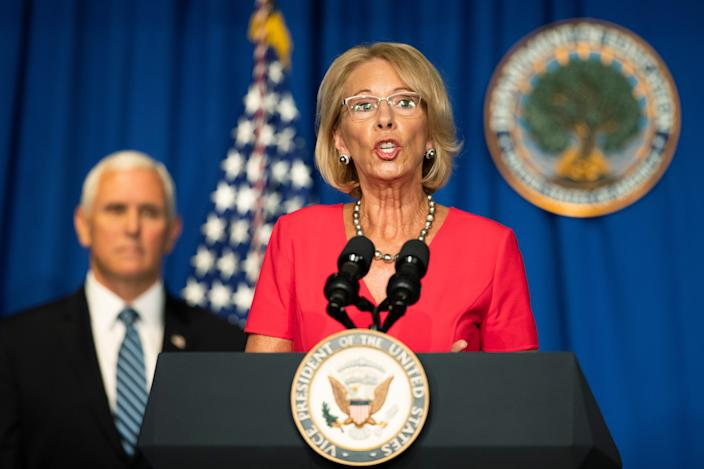 Education Secretary Betsy DeVos, with Vice President Mike Pence, speaks during a White House Coronavirus Task Force briefing at the Department of Education building Wednesday, July 8, 2020, in Washington.