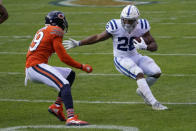 Indianapolis Colts' Jonathan Taylor (28) is tackled by Chicago Bears' Eddie Jackson (39) during the first half of an NFL football game, Sunday, Oct. 4, 2020, in Chicago. (AP Photo/Charles Rex Arbogast)