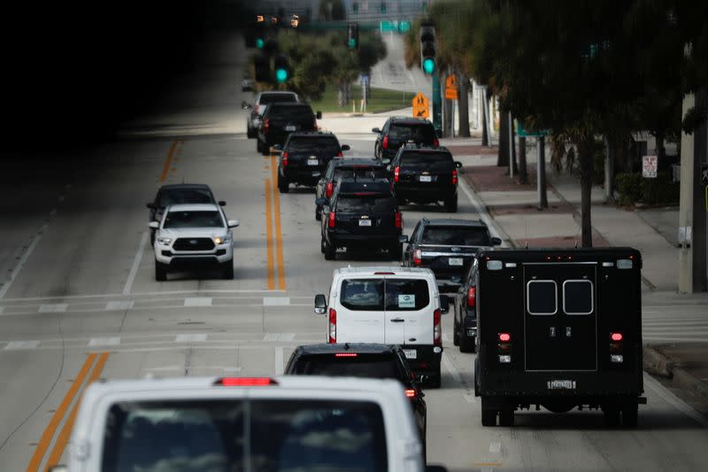 The presidential motorcade travels along Southern Boulevard before arriving at Trump International Golf Club in West Palm Beach