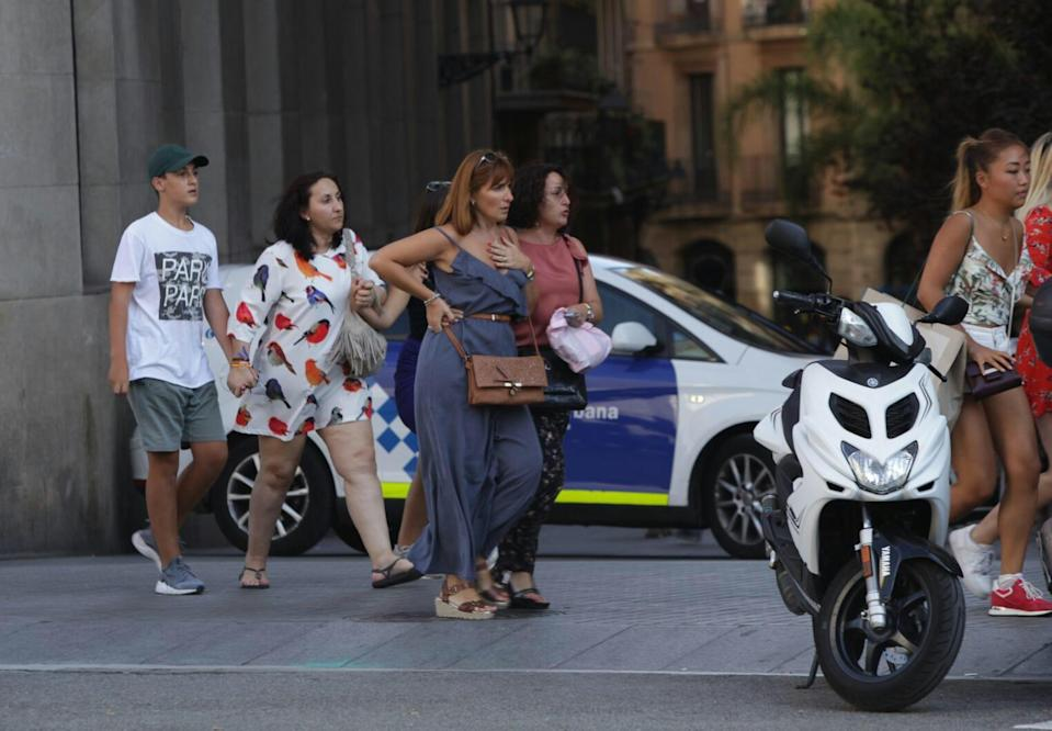 <p>People move away from the area after a van plowed into the crowd, injuring several people in Barcelona, Spain on August 17, 2017. (Albert Llop/Anadolu Agency/Getty Images) </p>