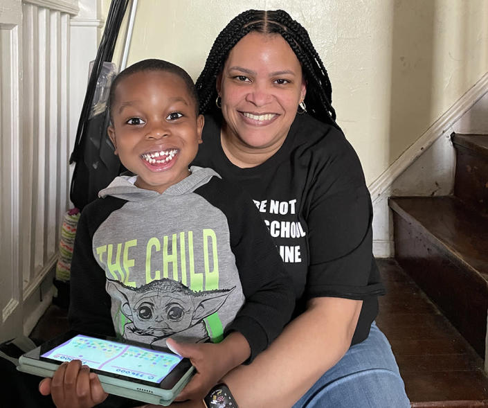 Maritza Guridy, a mother of four in Philadelphia, and her son Tarrell Adon Patterson-Guridy. (Mecca Khem)
