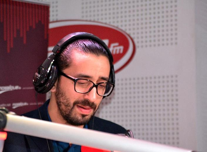 Tunisian comedian Migalo, whose real name is Wassim Lahrissi, records in the studios of the private radio station Mosaique FM on February 13, 2015 in Tunis (AFP Photo/Sofiene Hamadaoui)